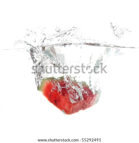 Watermelon falling in water - stock photo