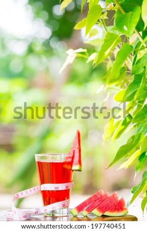 watermelon  healthy fruit and tape measure placed on the table in the morning. - stock photo
