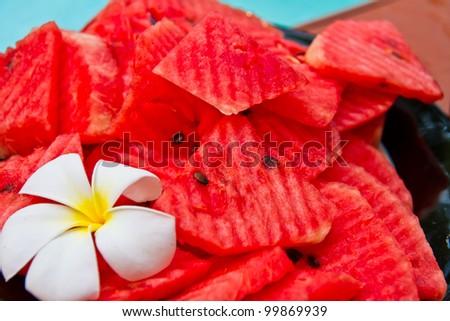 Watermelon in black dish - stock photo