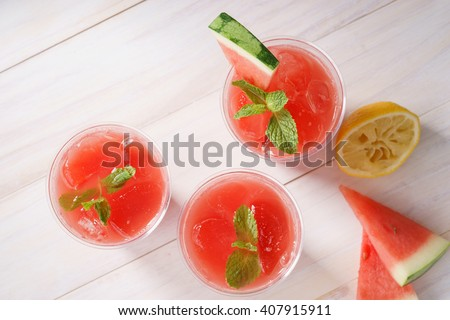 Watermelon juice in glasses with slices of watermelon - stock photo