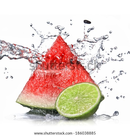 watermelon, lime and water splash isolated on white - stock photo