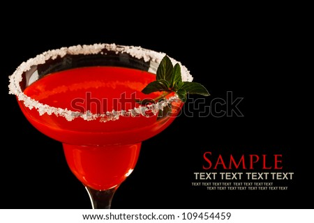 Watermelon martini drink with mint on black background - stock photo
