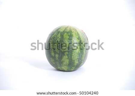 watermelon on a white background about security when cycling - stock photo