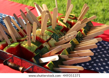 Watermelon pieces with wooden sticks for easy hold - stock photo