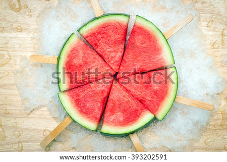 Watermelon popsicle on ice snowflake; delights of summer party (cool tone) - stock photo
