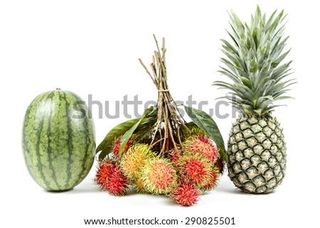 Watermelon, rambutan and pineapple isolated on white background. - stock photo