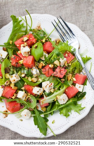 Watermelon salad with feta and nuts - stock photo