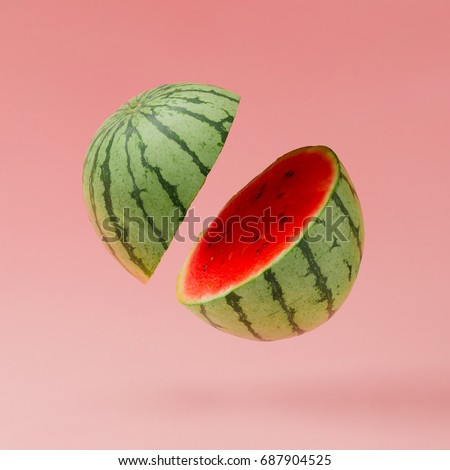 Watermelon sliced on pastel pink background. Minimal fruit concept.