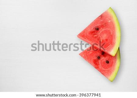 Watermelon slices on white table - stock photo
