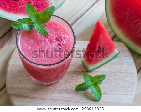 watermelon smoothie on a wooden table - stock photo