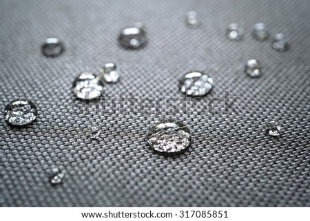Waterproof coating background with water drops - stock photo