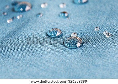waterproof fabric with waterdrops - stock photo