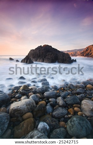 waterscape with rocks and moving waves