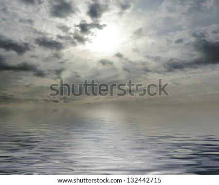 Waterscape with sun behind cloudy sky - stock photo