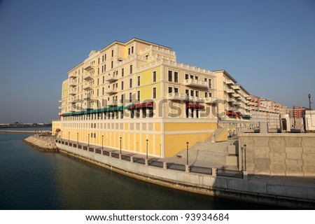 Waterside building of Qanat Quartier at The Pearl in Doha, Qatar - stock photo