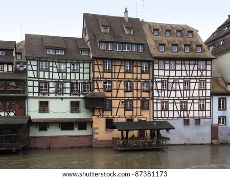 waterside canal scenery in Strasbourg with pictoral timbered houses (Alsace/France) - stock photo