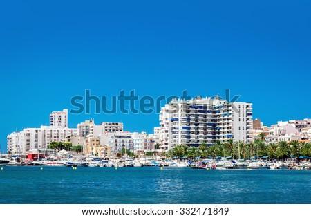 Waterside view to San Antonio de Portmany harbor. San Antonio (also Sant Antoni) is the second largest town in Ibiza. Balearic Islands. Spain  - stock photo
