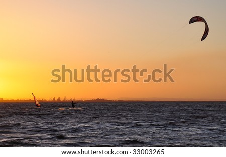 Watersports at sunset - stock photo