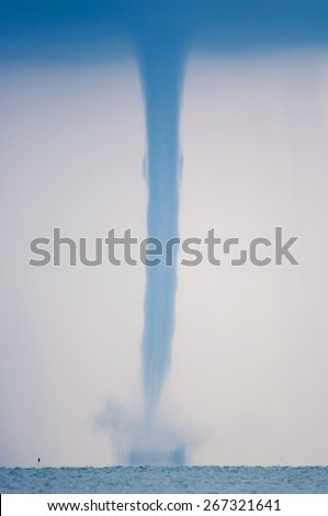 Waterspout on the ocean - stock photo