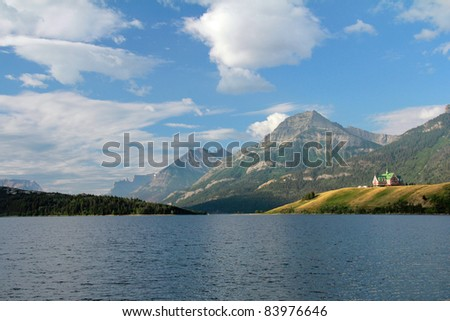 Waterton Lake with Historic Prince of Wales Hotel in the Background - Waterton Lakes National Park, Alberta, Canada - stock photo