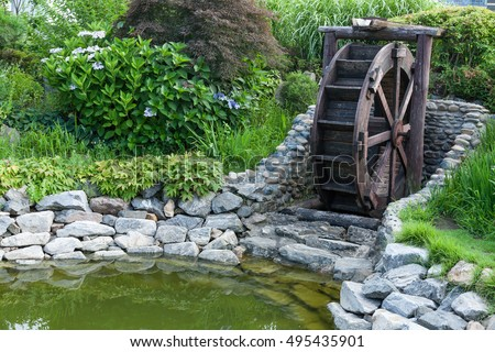 Waterwheel In Garden