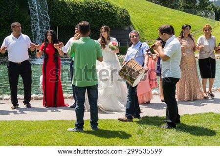 WATTENS, AUSTRIA - JULY 4, 2015: Unidentified arabic people celebrating a wedding and dancing. Dancing is one of the main parts of wedding in the arabic world