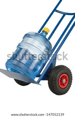 Watter jug on the cart. Clode-up of hand truck with a water jug on it isolated on white - stock photo
