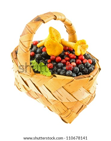 Wattled basket with berries and mushrooms isolated on a white background.