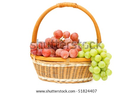 Wattled basket with grapes isolated on white - stock photo