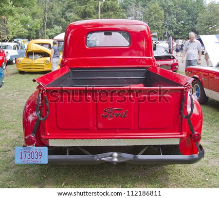 WAUPACA, WI - AUGUST 25: Back view of 1950 Ford F1 red Pickup truck at the 10th Annual Waupaca Rod & Classic Car Club Car Show on August 25, 2012 in Waupaca, Wisconsin. - stock photo