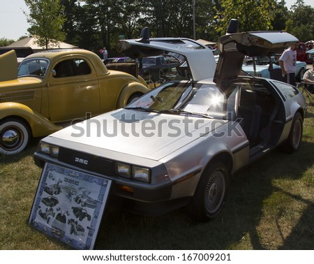 WAUPACA, WI - AUGUST 24:  1981 DeLorean Car at Waupaca Rod and Classic Annual Car Show August 24, 2013 in Waupaca, Wisconsin. - stock photo