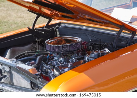 WAUPACA, WI - AUGUST 24, 2013:  Engine of 1966 Orange Chevy El Camino car at Waupaca Rod and Classic Annual Car Show August 24, 2013 in Waupaca, Wisconsin.