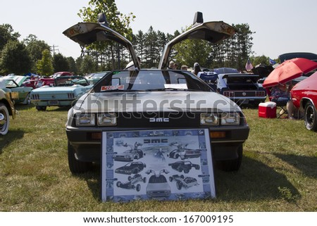 WAUPACA, WI - AUGUST 24:  Front of 1981 DeLorean Car at Waupaca Rod and Classic Annual Car Show August 24, 2013 in Waupaca, Wisconsin. - stock photo