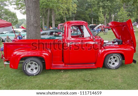 WAUPACA, WI - AUGUST 25: Red 1955 Ford F-100 Pickup Truck at the 10th Annual Waupaca Rod & Classic Car Club Car Show on August 25, 2012 in Waupaca, Wisconsin. - stock photo