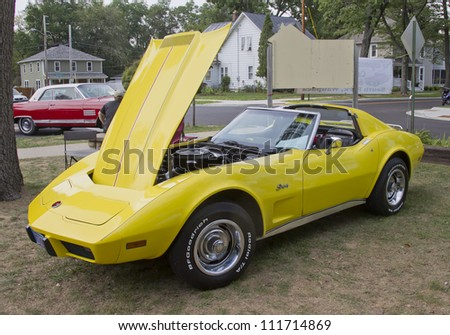WAUPACA, WI - AUGUST 25: Side view of a yellow 1975 Chevy Corvette Stingray classic car at the 10th Annual Waupaca Rod & Classic Car Club Car Show on August 25, 2012 in Waupaca, Wisconsin. - stock photo