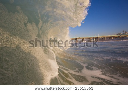 Wave and Beach with Pier - stock photo