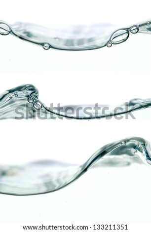 wave and bubbles isolated on white - stock photo