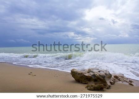 Wave and stone. Crimean Black sea coast - stock photo