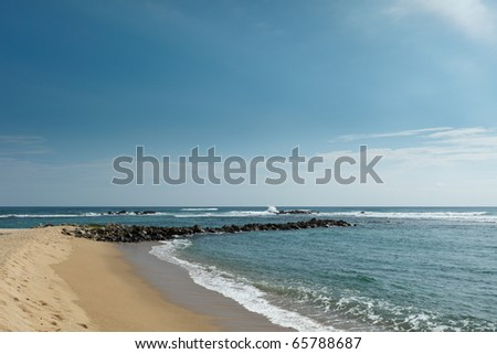 Wave breaker on beach. Mirissa, Sri Lanka - stock photo