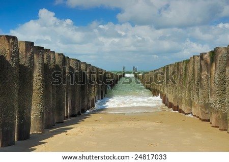 wave breakers on the beach - stock photo