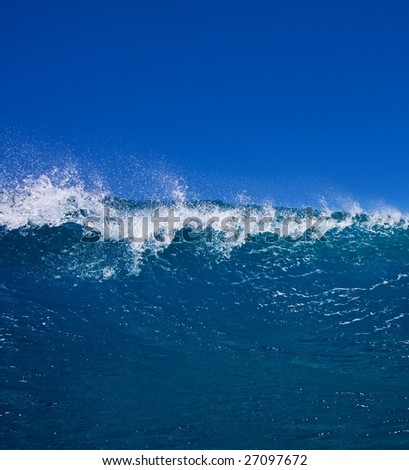 Wave Breaking in Ocean with Blue Sky - stock photo