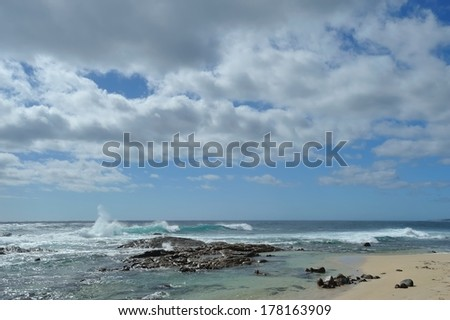 Wave breaking on rocks, Quinninup beach, Western Australia - stock photo
