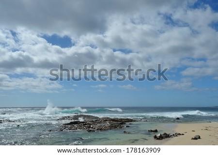 Wave breaking on rocks, Quinninup beach, Western Australia - stock photo