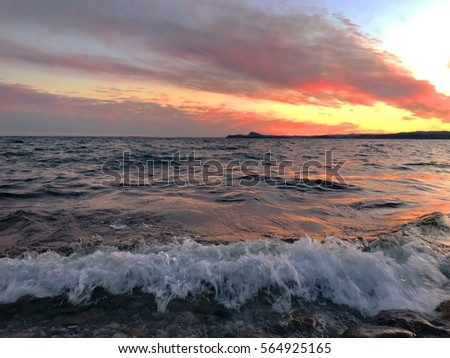 wave breaking on the shore at sunset