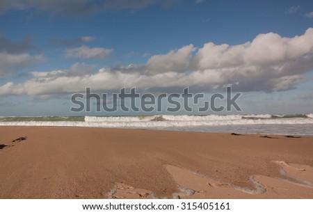 wave breaking onto a beach, Turihaua, East Coast, North Island, New Zealand  - stock photo