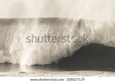 Wave Crashing Beach Black White Vintage Ocean wave crashing towards beach coastline in black white vintage tone - stock photo