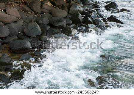 Wave crashing on the rocky reef - stock photo