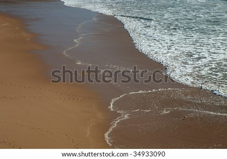 wave detail on a beach at the south of portugal - stock photo