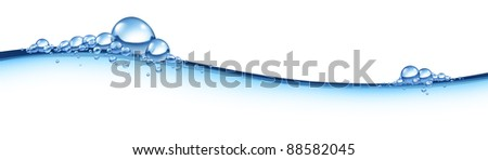 Wave in blue flowing horizontal liquid with bubbles representing the concept of clean fresh H2o as a symbol purity of health and the freshness of pure nature. - stock photo