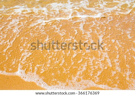 Wave it through the sand. - stock photo